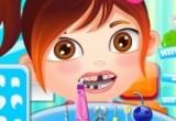 لعبة الطفلة كارمن في عيادة طبيب الأسنان